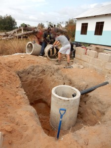 Laying drainage for the Kindergarten toilet block in Kindwitwi