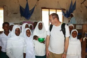 Richard with school children in Kindwitwi
