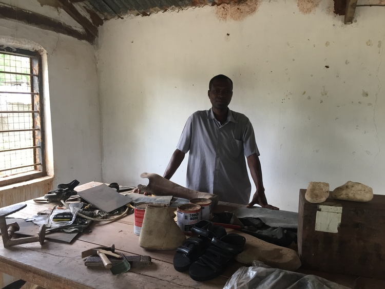 Salumu in his workshop